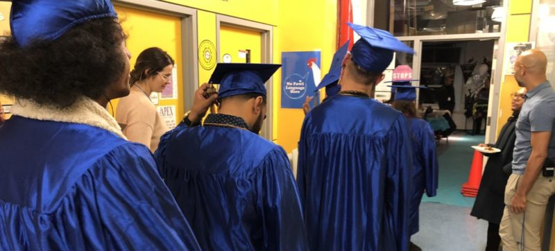 Students celebrate completing their high school equivalency at LGBTQ youth services agency HMI
